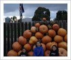 My Grandchildren with their giant Pumpkins.